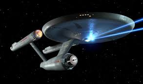 LISTEN UP GEEKS! This starship isn't exactly the business 'enterprise', but it's close enough. Note: It is firing it's phasers!