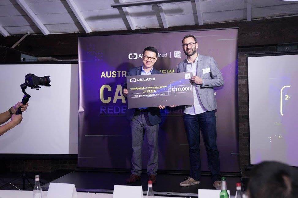 David Haynes of QuestaGame accepting a large novelty cheque upon qualifying for the global final.