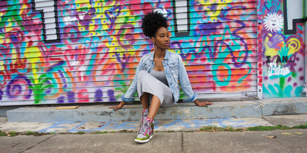 Dresses to wear with sneakers? Yes, it's possible! Got my shoes bedazzled and a basic dress to complete this sneaker outfit. You'll also find a couple of dresses in this post to help you develop your own sneaker style.  Photo taken in Houston, in front of a graffiti mural. Rocking some custom made nikes.
