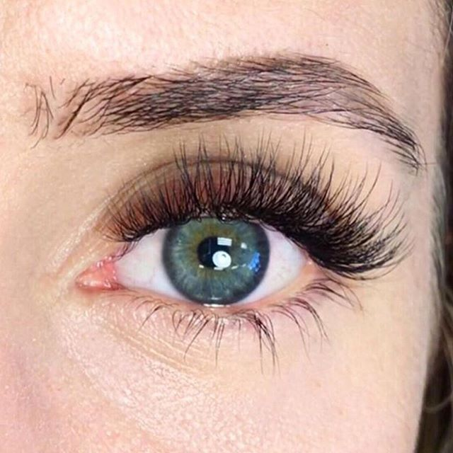 This is the first Volume set I ever did! I knew that my friend, who was my model, didn't want anything too dramatic for her first experience with lash extensions and she typically stays on the more natural side. You guys know me, I'm all about embracing and only enhancing what is naturally already yours! See those amazingly long bottom NLs? 😍 Those bad boys told me she could carry a longer look really well, but I also needed to stay softer with my result, so... I had to go wispy with the tips. At the time, when I first learned how to lash, there wasn't all this mapping info out there that we have now about styling. All my looks were based off my own experiences purchasing strip lashes of all variety's and of just visually assessing my client's face and what her desired outcome was. I am alllll about a good strategy, a plan and an executed lash map these days, but there's so much to be said about using your artistic vision and just creating something by sight. I used longer layers to create those softer tips and shorter lengths throughout to provide her that dense look at the base. I didn't know what I was doing, could hardly even make fans, but I had set my intentions with my vision for her and it worked out! Trust your artistic abilities, get some models and take risks! You'll be so happy you did! ✨🖤 #jbrandbeauty #lashmaps #lashcreativity #lashlooks #jbranded #simplifiedluxury