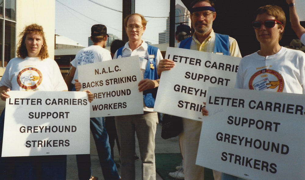 It's heredi-solidarity - My mother (left) and aunt (right) showing solidarity as postal employees, 1990