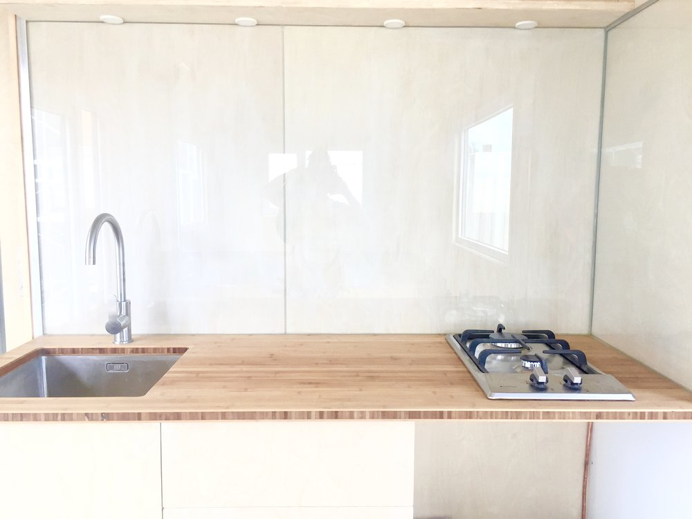 Glass splash back with timber behind