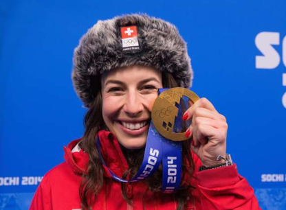 Dominique celebrated her greatest victory in Sotchi, Russia, on February 12, 2014, when she was the fastest athlete down the course and won the downhill Olympic Gold medal. During the same Olympic Winter Games, she finished 5th in the super combination event. Further great athletic achievements include two top 5 positions in World Championships and 49 top 10 ranks in FIS World Cup races, 3 of them at the very top of the podium as number one. As a sign of her great achievements, Dominique was named female athlete of the year in Switzerland in 2014.  In 2015, after 8 years in the Swiss National Ski-team, Dominique decided to step back from competing at the highest levels to focus her energy on her academic education aiming at achieving her M.Sc. in physics.Next to her academic studies, Dominique studies and trains to extend her general aviation license to the commercial pilot license and she has co-authored the book Making it Happen, building on her experiences of highs and lows during her time as an elite athlete. In what's left of her leisure time, she is still a passionate skier, and an accomplished golfer with a 10.7 handicap.