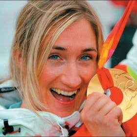 Tanja celebrated her greatest victory in Turin, Italy, on February 17, 2006, when she won the Olympic Gold medal in the Snowboard-cross competition, as the first ever in this discipline. At the end of that winter, she finished 2nd in the overall Snowboard-cross World Cup. Her athletic career began in 1996, lasting 14 years until withdrawing from active competitions in 2010 after sustaining serious injuries in a crash in a race. By that time, her achievements included the silver medal in the 1999 European Championships and a total of 32 top-three positions in the highest ranking international Snowboard-cross competitions. As a true international, she raced for Norway in the beginning and ended competing for Switzerland. And in appreciation of her great athletic achievements, Tanja was named Swiss female athlete of the year in 2006.  Shortly after ending her athletic career, Tanja ventured into charitable and social engagements. She has been an athlete ambassador for  Right To Play  for many years, and still is. And she is the acting president of the association   GoSnow.ch  , called to life to increase the attractiveness of snow-related activities and ski camps amongst school children.  In all these activities, Tanja involves herself with great enthusiasm and much energy. Still, she is able to devote time to her successful personal coaching business and taking on assignments as key-note speaker for audiences from the worlds of business and sport. All this in addition to her family life, bringing up her three year old son Luam together with her partner, Marc.