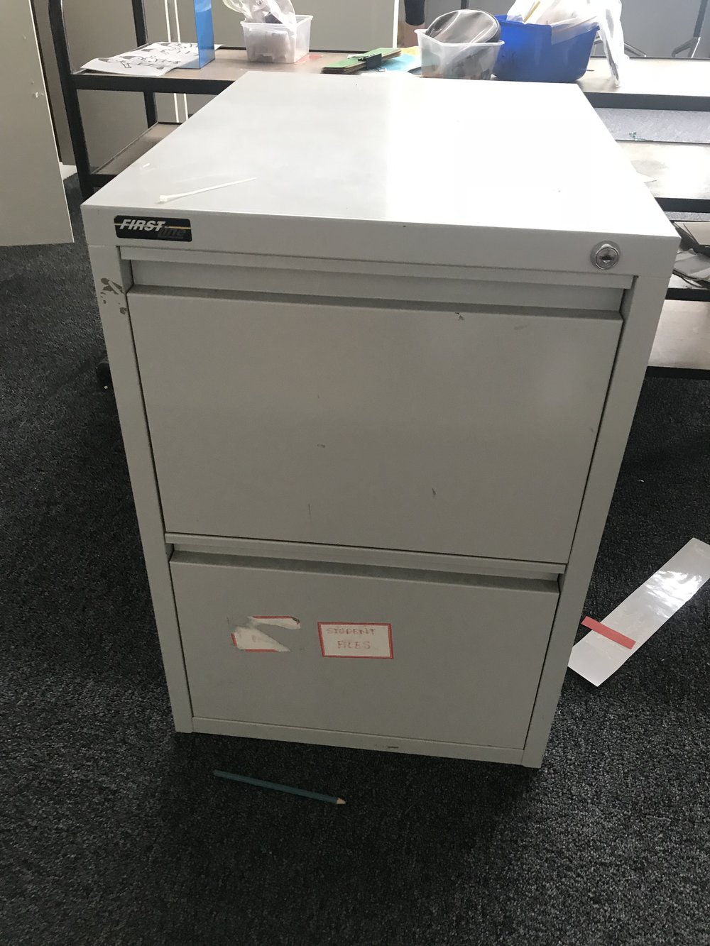 2 x filing cabinets - 1 in great condition, other not so great but good for garage storage