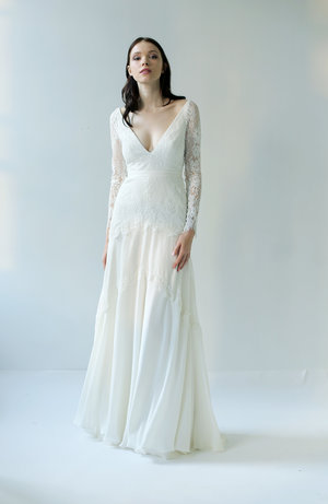 fba581f1839bb Addison light ivory lace and silk chiffon with long lace sleeves. It has  both a v