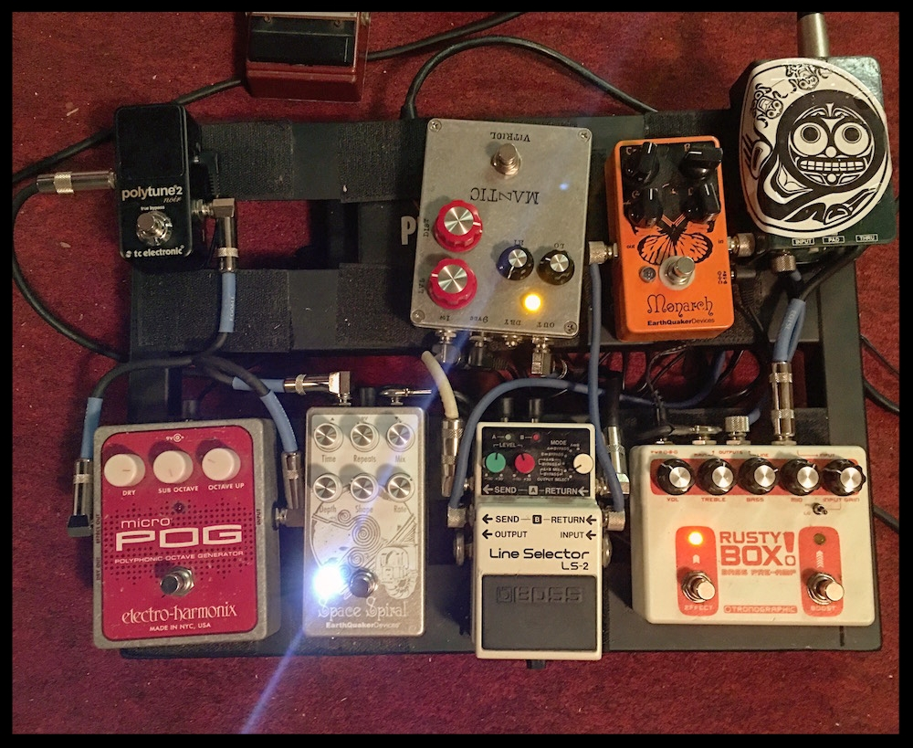 Line out from my bass preamp (first in chain, bottom right) to the DI I keep on my pedalboard (top right). Photo: Bradley Thorla