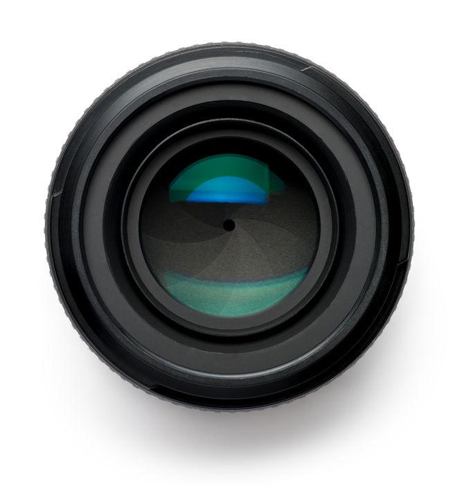 31760068 - 50mm camera lens on white