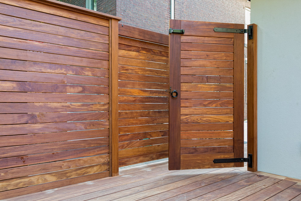 Toronto, Canada 2017  Designed by  Anex Works Inc  and in collaboration with the end-client,  this project features solid handcrafted solid Sandeka gates, fencing and decks.  All work executed by Anex skilled tradespeople and utilizing the best hardware available.
