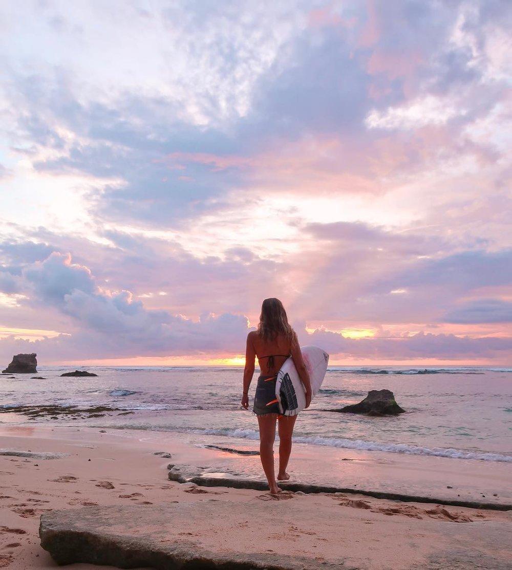 secret beach surfing uluwatu bali - elise darma