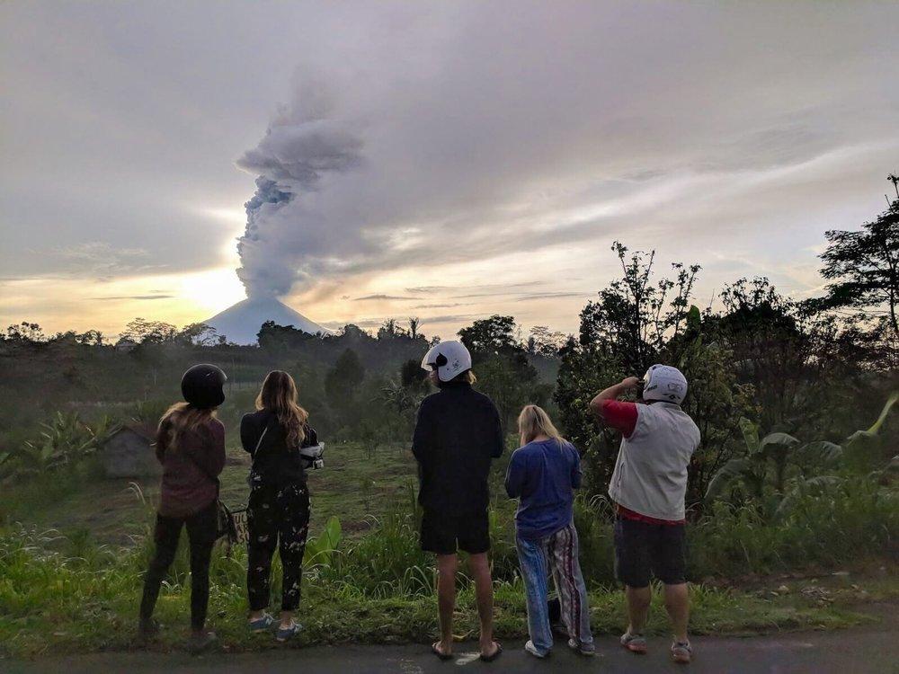 mount agung erupting bali - elise darma