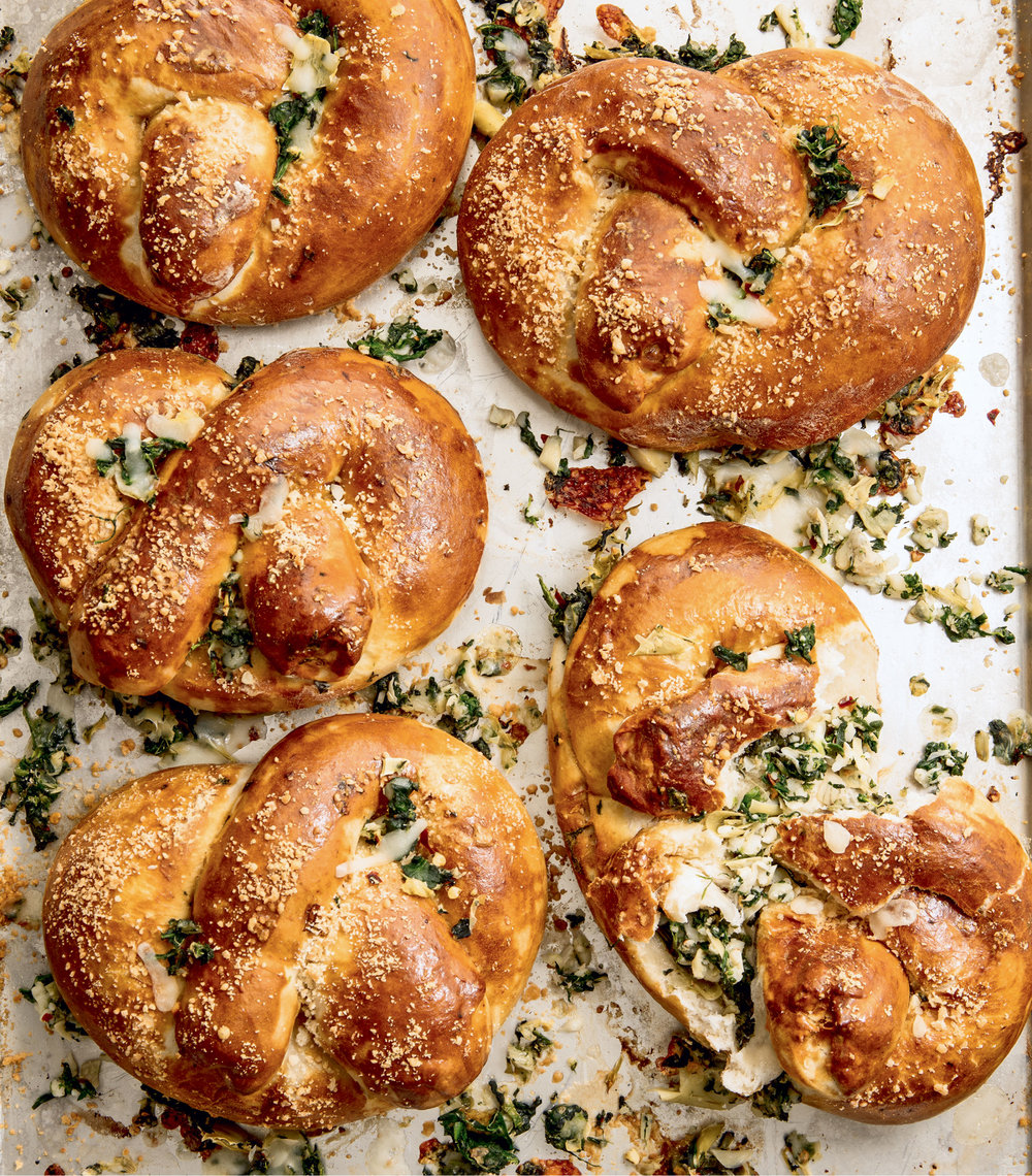 Spinach Artichoke Stuffed Pretzels (Delish Cookbook), Photo by Ethan Calabrese
