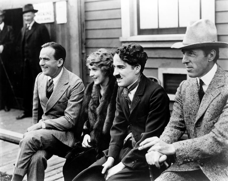 hauntedbystorytelling :     Douglas Fairbanks, Mary Pickford, Charlie Chaplin [as The Tramp] and director D.W. Griffith announce the formation of the United Artists corporation, Feb. 1919        what a bunch of goddamn legends
