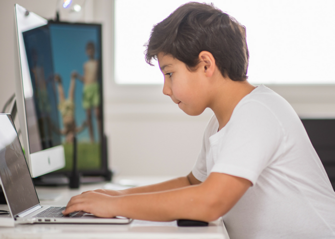 Boy at computer_ Raising Successful Kids _ www.fortheloveofmom.org