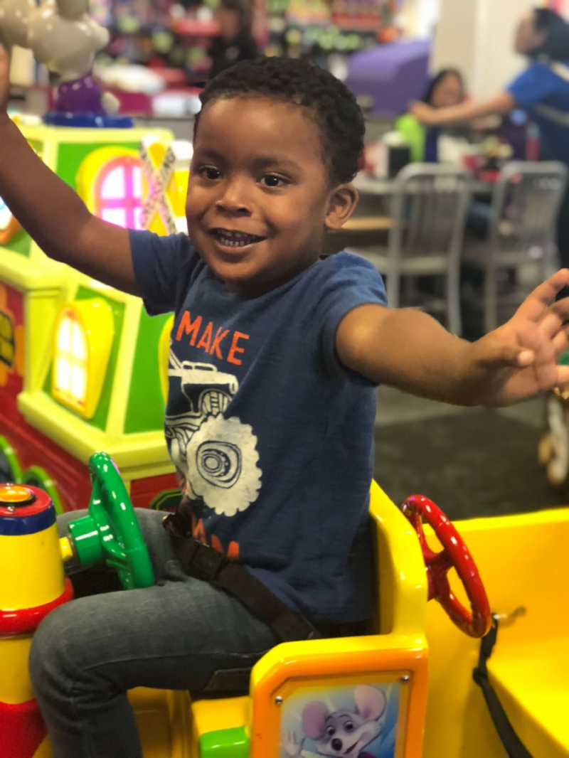 Boy-On-Train-At-Chuck-E-Cheeses-fortheloveofmom.org