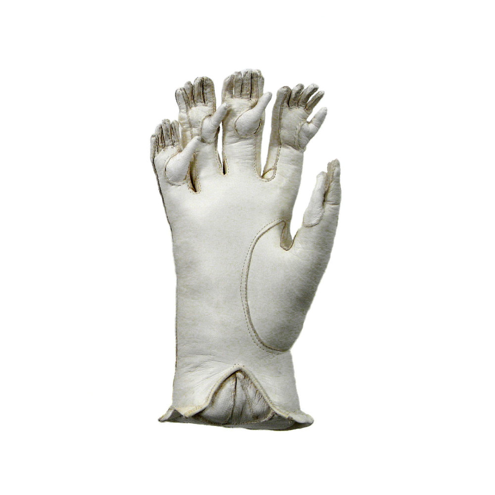 ONTONGENUS, 2005.  (Right hand of a pair) Altered leather glove, wire, sawdust; wall mounted; 7 x 5 x 3 inches