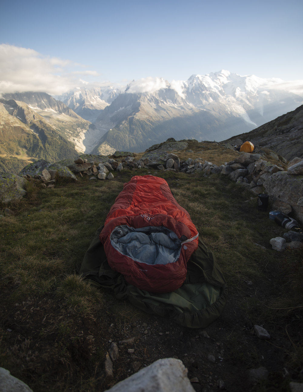 Bivi spot below the Aigulles Rouge in the Chamonix Valley. Ahead one can see the Mont Blanc, Aiguille de Midi, Grand Jorasses and Mer de Glace.  Rab Ascent 900 sleeping bag used here.