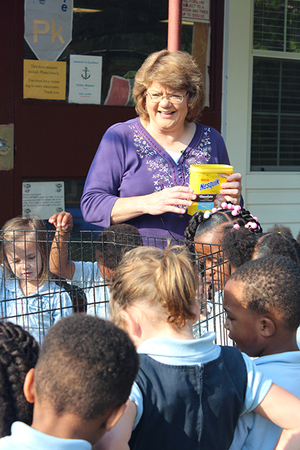 Vickie Mayeaux helps her pre-K class making the connection between full bellies and farming.  Mayeaux's class raised carrots and chickens through the school year not only to teach her class about agriculture, but using ag as a way of teaching math, science and reading. Mayeaux said making that connection is important for students of any age and many of the other classes at Cottonport Elementary used the Ag in the Classroom material to teach their students as well. Photo by Monica Velasquez.