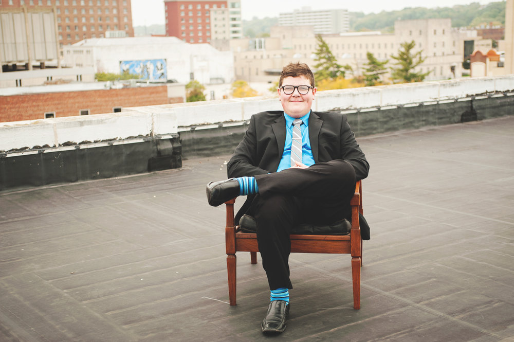 Sometimes you just gotta chill on a roof in a suit.  Caleb Duhon,  he's going to be taking on the world in a few years.  I think he's ready.