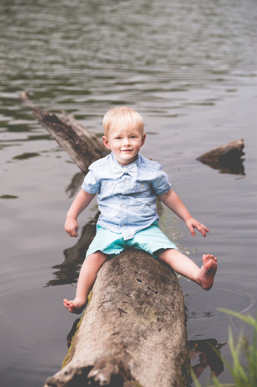 A log, a lake and a little boy. Easy as pie.
