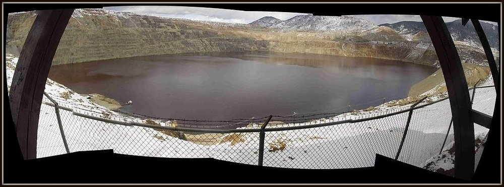 Panorama of The Berkeley Pit, the largest super fund site in the United States, result of open-pit mining. Butte, Montana  © William E. Rosmus