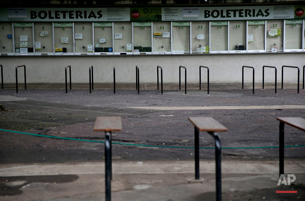 Ticket booths stand shuttered at the former Buenos Aires Zoo in Argentina, Friday, July 1, 2016. (AP Photo/Natacha Pisarenko)