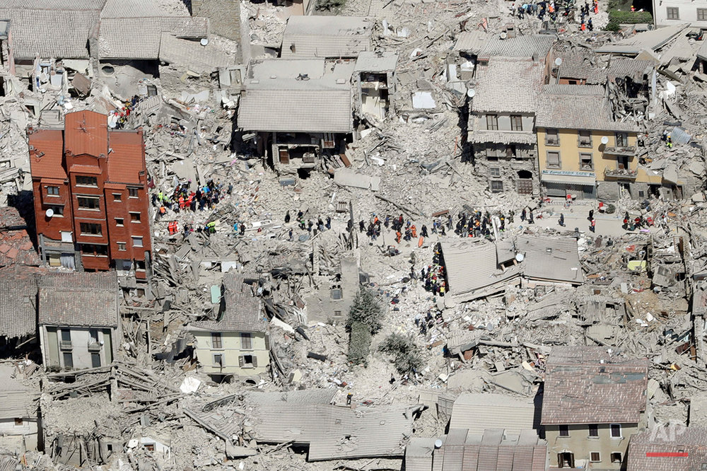 This aerial photo shows the damaged buildings in the town of Amatrice, central Italy, after an earthquake, Wednesday, Aug. 24, 2016. The magnitude 6 quake struck at 3:36 a.m. (0136 GMT) and was felt across a broad swath of central Italy, including Rome where residents of the capital felt a long swaying followed by aftershocks. (AP Photo/Gregorio Borgia)