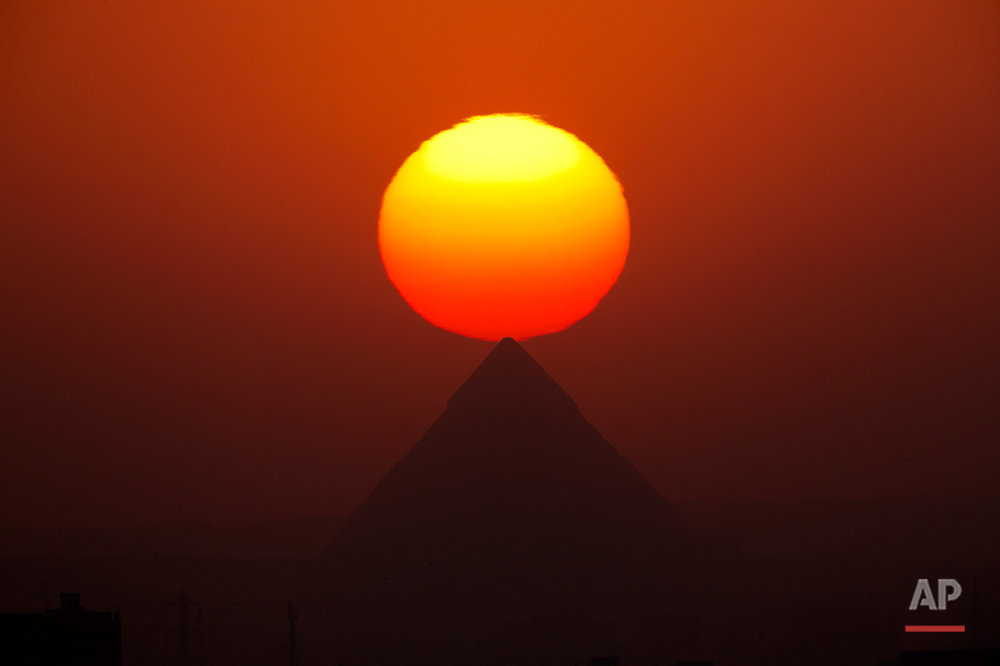 The sun sets over the Giza Pyramids, near Cairo, Egypt, Friday, Aug. 19, 2016. (AP Photo/Amr Nabil)