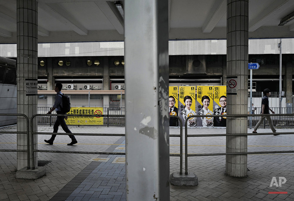 In this Aug. 30, 2016 photo, election posters promoting candidates from the radical People Power party are seen at a walkway in Hong Kong. Hong Kongers head to the polls Sunday, Sept. 4, 2016 to choose candidates for the semiautonomous city's legislature, in the first major election since 2014's pro-democracy street protests. That movement drew world attention to the former British colony's struggle over stunted democratic development under Chinese rule and paved the way for a burgeoning independence movement that's complicating the upcoming vote. (AP Photo/Vincent Yu)