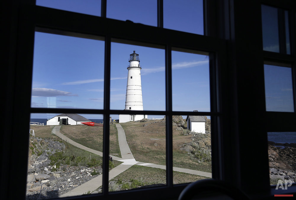 In this Aug. 17, 2016 photo, Boston Light, America's oldest lighthouse, is seen through a window of the keeper's house on Little Brewster Island in Boston Harbor. (AP Photo/Elise Amendola) See these photos on  APImages.com