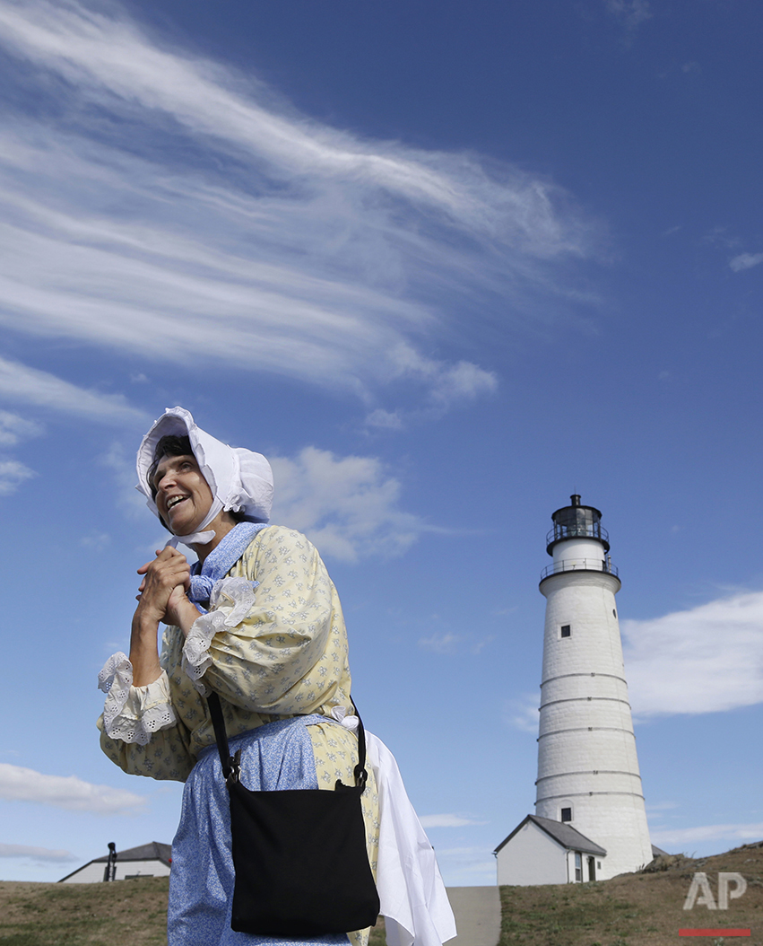 In this Aug. 17, 2016 photo, Sally Snowman, the keeper of Boston Light, wears Revolutionary-era clothing as she speaks about its history on Little Brewster Island in Boston Harbor. The U.S. Coast Guard's last manned station will celebrate the 300th anniversary of its first lighting on Sept. 14. (AP Photo/Elise Amendola) See these photos on  APImages.com