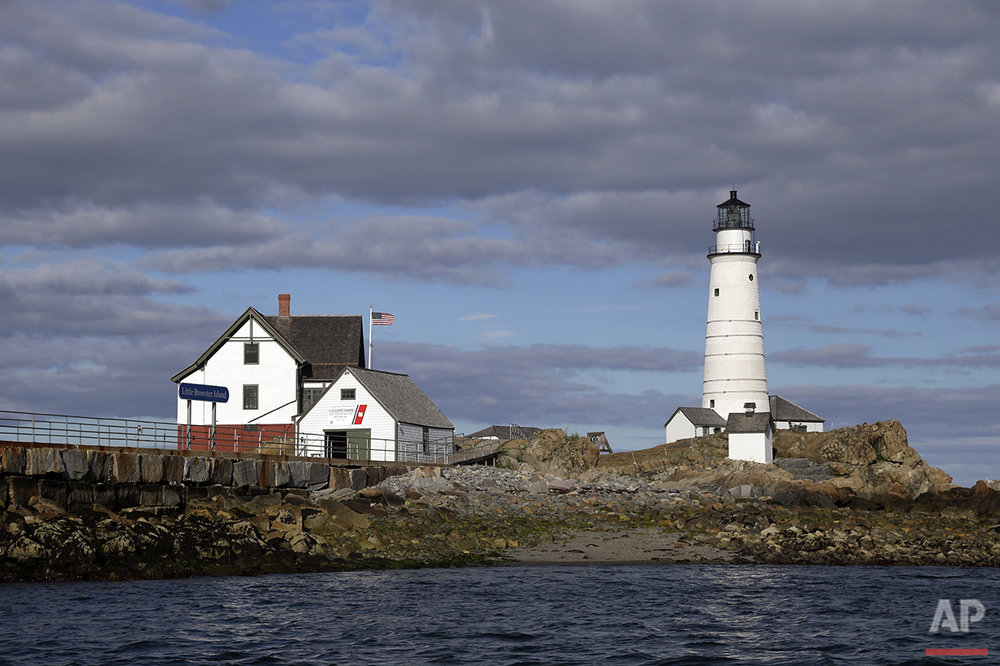 In this Aug. 17, 2016 photo, Boston Light, America's oldest lighthouse, sits on Little Brewster Island in Boston Harbor. (AP Photo/Elise Amendola) See these photos on  APImages.com