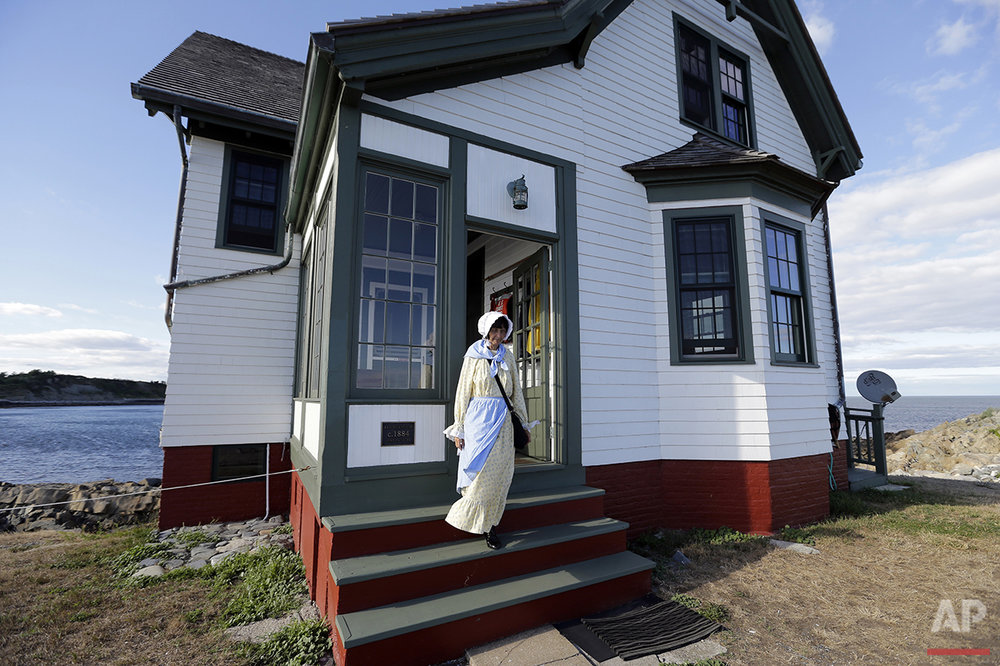 In this Aug. 17, 2016 photo, Sally Snowman, the keeper of Boston Light, steps from the keeper's house on Little Brewster Island in Boston Harbor. (AP Photo/Elise Amendola) See these photos on  APImages.com
