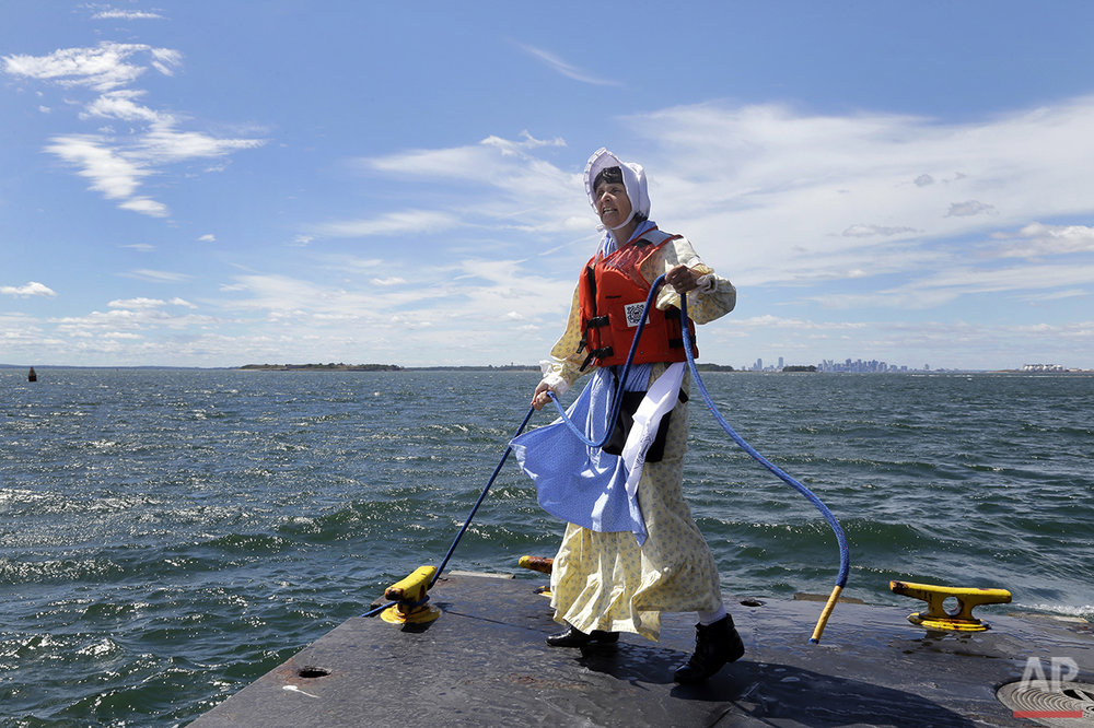 In this Aug. 17, 2016 photo, Sally Snowman, the keeper of Boston Light, unties a dock line at Little Brewster Island in Boston Harbor. (AP Photo/Elise Amendola) See these photos on  APImages.com