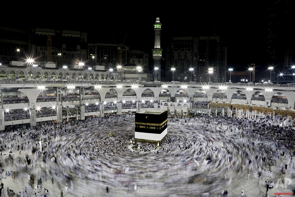 In this Wednesday, Sept. 7, 2016 photo, Muslim pilgrims circle the Kaaba, Islam's holiest shrine, at the Grand Mosque in the Muslim holy city of Mecca, Saudi Arabia. Muslim pilgrims have begun arriving at the holiest sites in Islam ahead of the annual hajj pilgrimage in Saudi Arabia, with some weeping with their hands outstretched for a fleeting touch of the Kaaba. The cube-shaped shrine, at the center of Mecca's Grand Mosque, is the site the world's 1.6 billion Muslims pray toward five times a day. (AP Photo/Nariman El-Mofty)