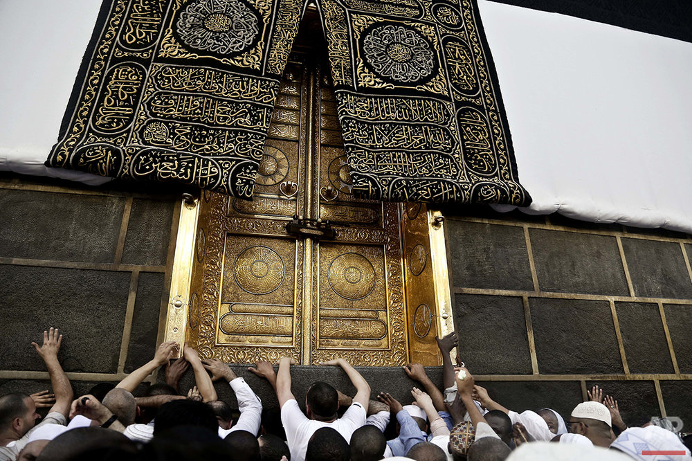 Muslim pilgrims touch the golden door of the Kaaba, Islam's holiest shrine, at the Grand Mosque in the Muslim holy city of Mecca, Saudi Arabia, Wednesday, Sept. 7, 2016. Millions of pilgrims have arrived to Mecca ahead of the Hajj annual pilgrimage which begins Saturday, Sept. 10, 2016. (AP Photo/Nariman El-Mofty)