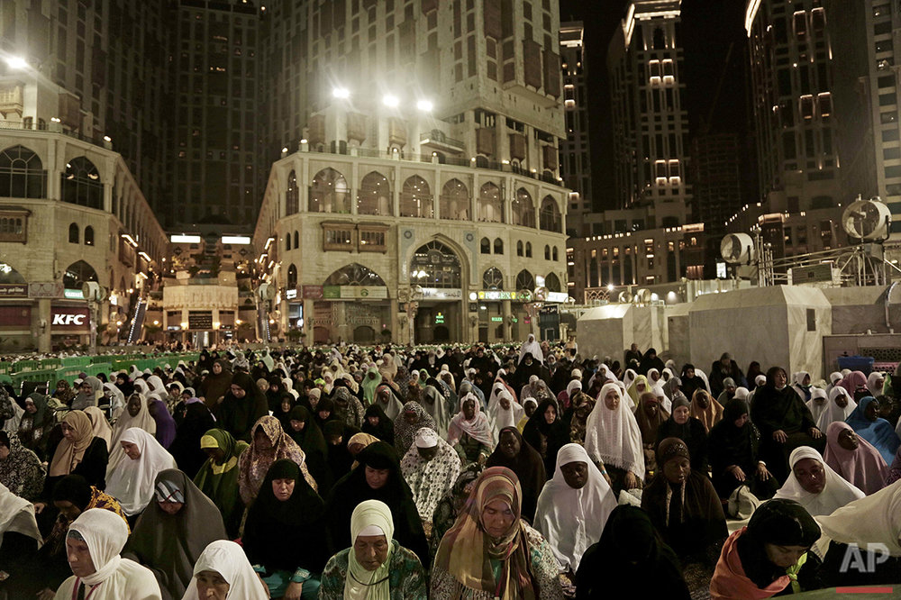 Muslim pilgrims pray Fajr, prayer before sunrise, outside the Grand Mosque in the Muslim holy city of Mecca, Saudi Arabia, Thursday, Sept. 8, 2016. Millions of pilgrims have arrived to Mecca ahead of the Hajj annual pilgrimage which begins Saturday, Sept. 10, 2016. (AP Photo/Nariman El-Mofty)