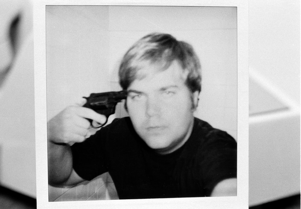 John W. Hinckley Jr., who attempted to assassinate President Ronald Reagan in March 1981, holds a pistol to his head in this self-portrait and obtained from court records in Oct. 1982.  The FBI released the polaroid image, which was part of the evidence used in Hicnkley's trail.  (AP Photo)