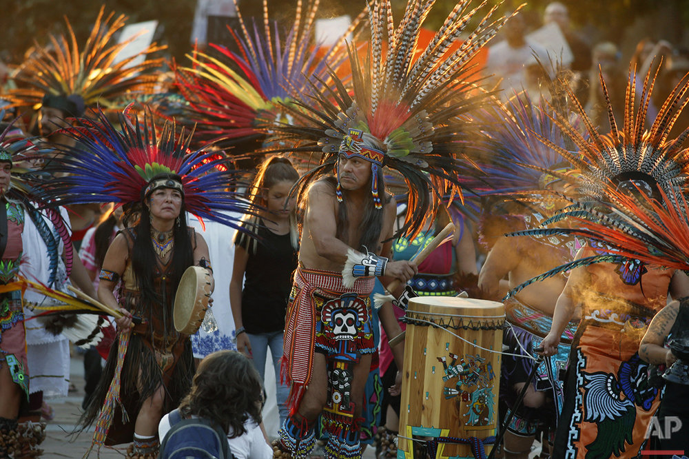 Native Americans head to a rally at the State Capitol in Denver, Thursday, Sept. 8, 2016, to protest in solidarity with members of the Standing Rock Sioux tribe in North Dakota over the construction of the Dakota Access oil pipeline. The tribe argues that the pipeline, which crosses four states to move oil from North Dakota to Illinois, threatens water supplies and has already disrupted sacred sites. (AP Photo/David Zalubowski)