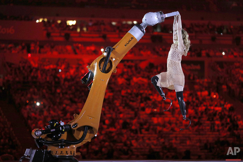 Amputee Amy Purdy dances with a robot during the opening ceremony of the Rio 2016 Paralympic Games at Maracana Stadium in Rio de Janeiro, Wednesday, Sept. 7, 2016. (AP Photo/Mauro Pimentel)