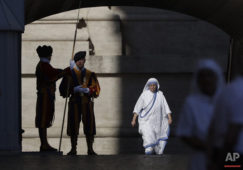 A Missionaries of Charity nun arrives in St. Peter's Square at the Vatican to attend a jubilee audience for workers and volunteers of mercy, Saturday, Sept. 3, 2016, a day before the canonization ceremony for Mother Teresa, who died in 1997. (AP Photo/Alessandra Tarantino)