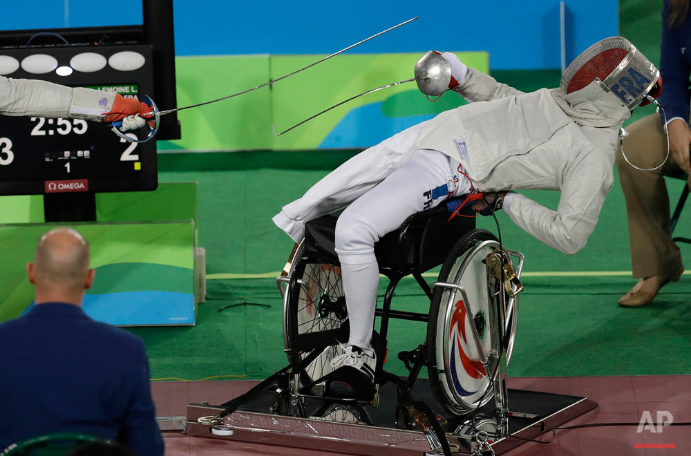 France's Ludovic Lemoine competes in the men's individual sabre, category A, wheelchair fencing event at the Paralympic Games in Rio de Janeiro, Brazil, Monday, Sept. 12, 2016. (AP Photo/Leo Correa)