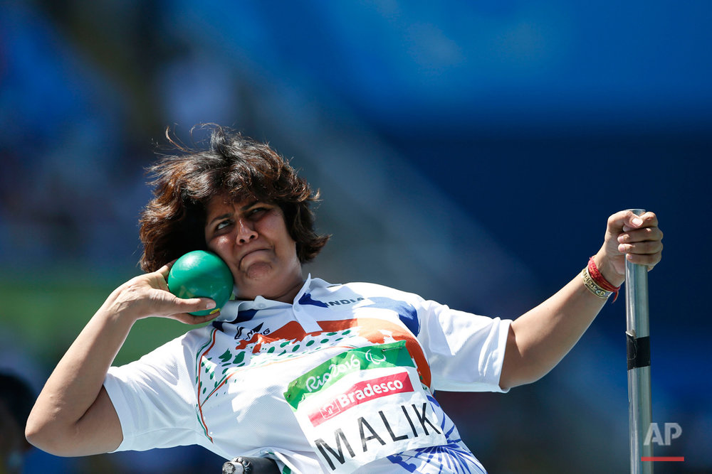 India's Deepa Malik competes to win the silver in the women's final shot put F53 athletics event during the Paralympic Games at Olympic Stadium in Rio de Janeiro, Brazil, Monday, Sept. 12, 2016. (AP Photo/Mauro Pimentel)