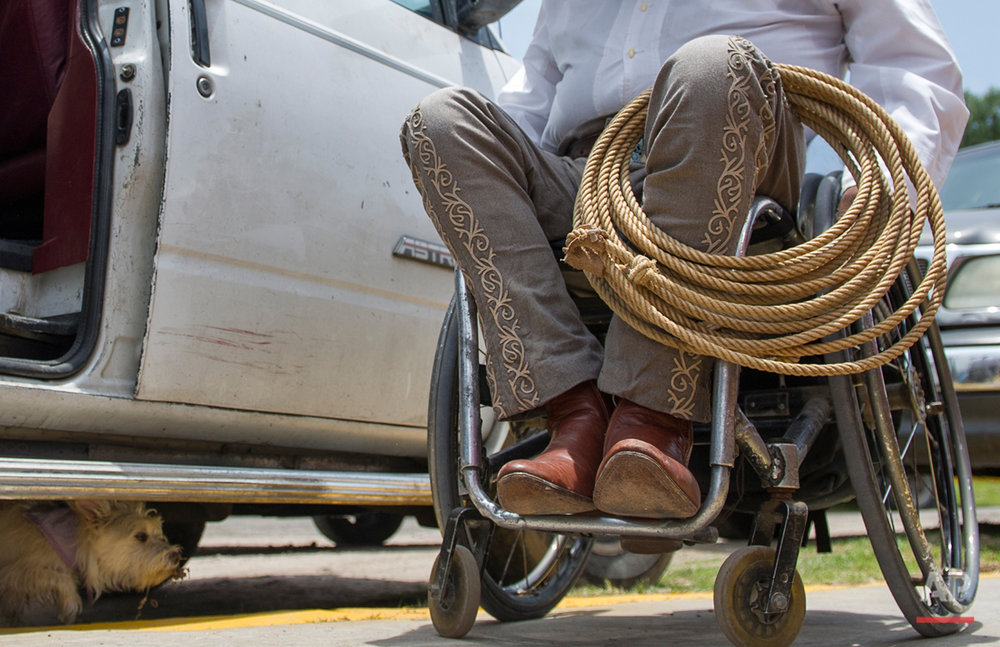 "In this July 10, 2016 photo, charro or Mexican cowboy Salvador Espinoza rests his lasso on his leg while calling for his dog Susana to hop into the van after arriving at at the Mexican rodeo arena in Cuautitlán Izcalli, Mexico. The first charreada, or team-competition rodeo, featuring people with disabilities took place in November 2011 as part of the cultural events of the Parapan American Games in Guadalajara, Mexico. In another first, the opening ceremony included a wheelchair performance of the jarabe tapatio, the folkloric tradition known abroad as the ""Mexican hat dance."" (AP Photo/Nick Wagner)"
