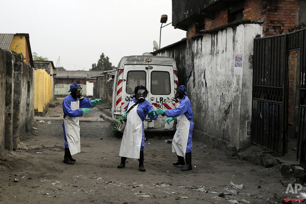 In this photo taken Friday July 22, 2016, teams from MSF carry out fumigation efforts in the Yolo Sud neighborhood of Kinshasa, Democratic Republic of Congo, in a bid to kill the mosquitos that transmit yellow fever.(AP Photo/Jerome Delay)