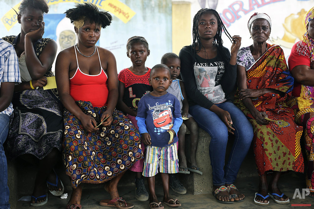 In this photo taken Sunday July 24, 2016, residents of the Kisenso district of Kinshasa, lineup to  receive yellow fever vaccines. (AP Photo/Jerome Delay)