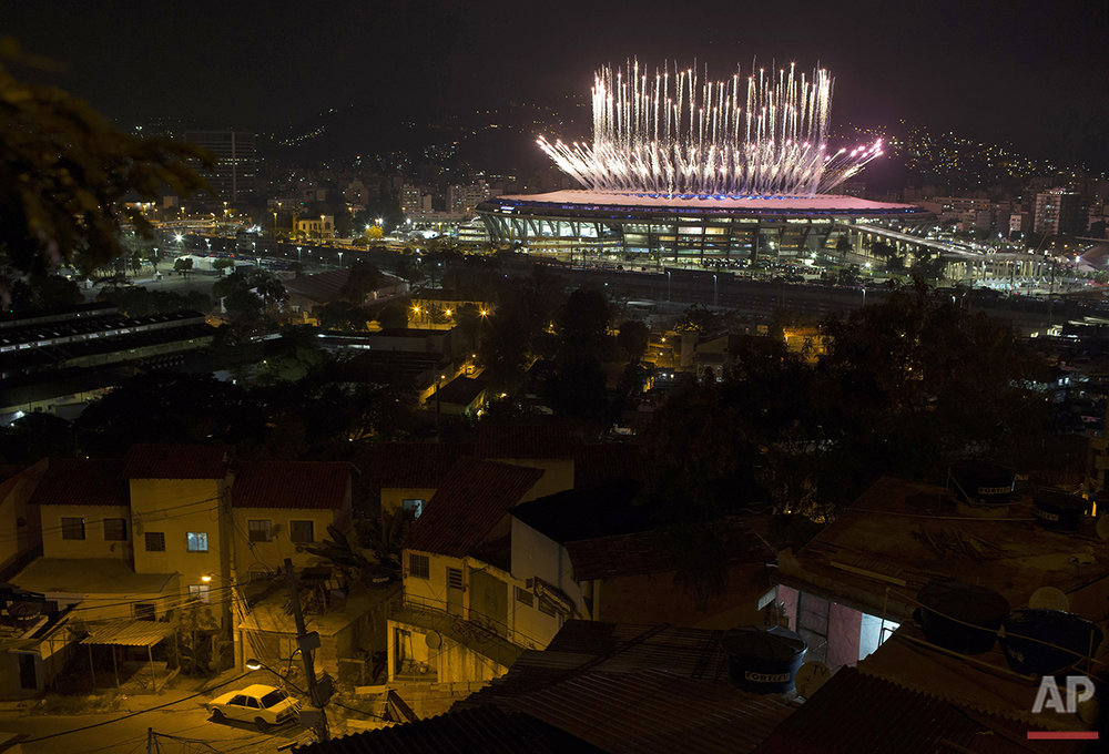 Fireworks explode above the Maracana stadium during the opening ceremony of the Rio's 2016 Summer Olympics in Rio de Janeiro, Brazil, Friday, Aug. 5, 2016. (AP Photo/Leo Correa)