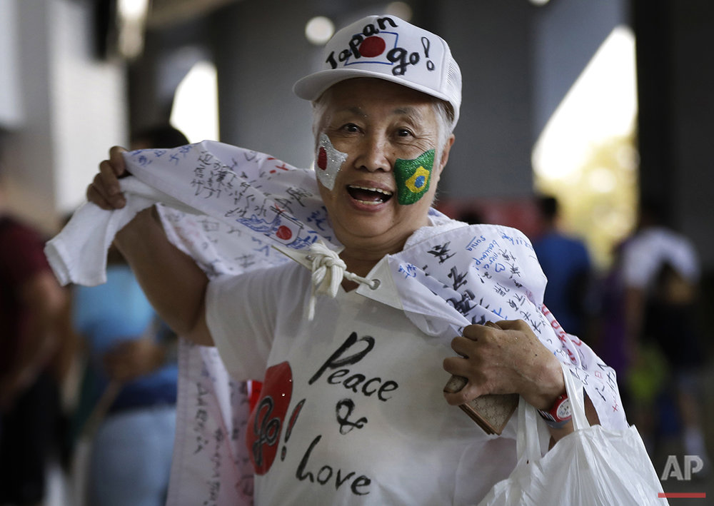 A Japanese fan arrives in a festive mood at the opening ceremony with flags of Japan and Brazil painted on her face at the 2016 Summer Olympics in Rio de Janeiro, Brazil, Friday, Aug. 5, 2016. (AP Photo/Robert F. Bukaty)