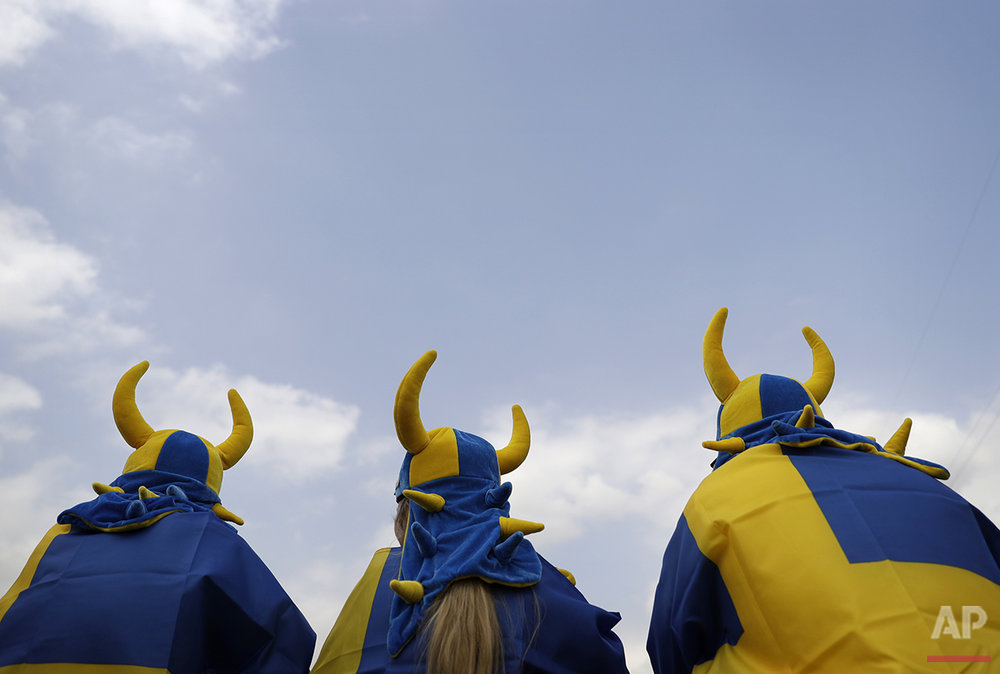 Swedish fans watch the equestrian eventing cross country phase at the 2016 Summer Olympics in Rio de Janeiro, Brazil, Monday, Aug. 8, 2016. (AP Photo/John Locher)
