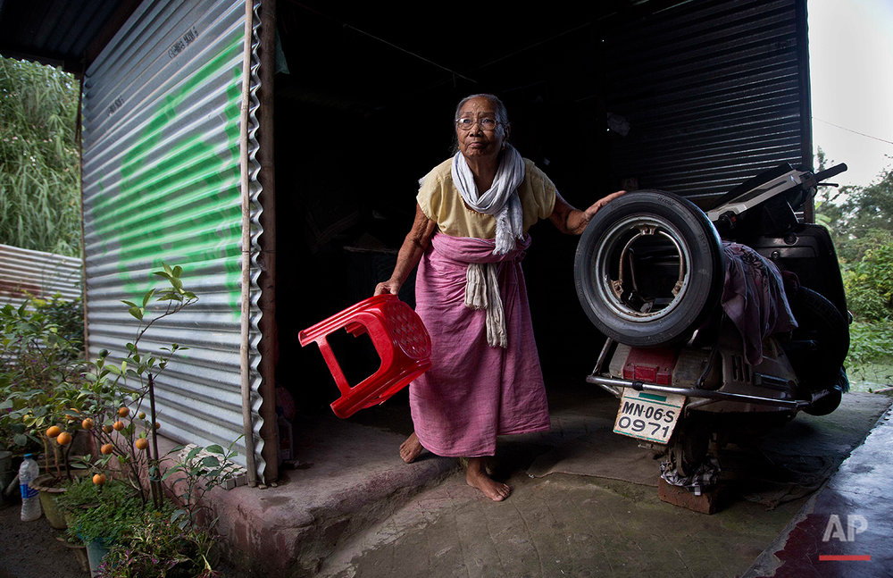 Irom Sakhi Devi, 84, mother of Indian activist Irom Sharmila, walks at her home in Imphal, northeastern Manipur state, India, Monday, Aug.8, 2016. Sharmila, the 44-year-old activist who has been on a hunger strike for nearly 16 years to protest alleged brutality by India's military is expected to end her fast on Tuesday, Aug. 9. (AP Photo/Anupam Nath)